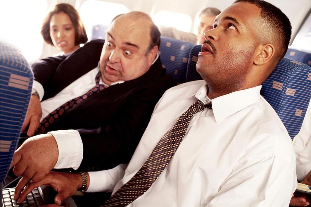 Who gets the armrest on an airplane?