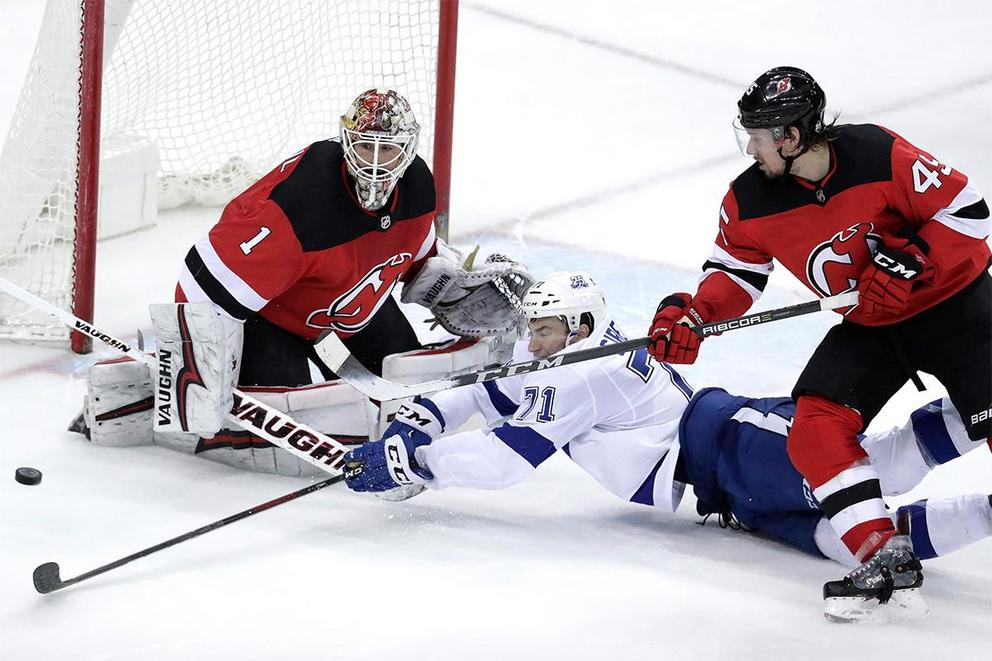 Which team will survive the first round of NHL playoffs: Tampa Bay Lightning or New Jersey Devils?