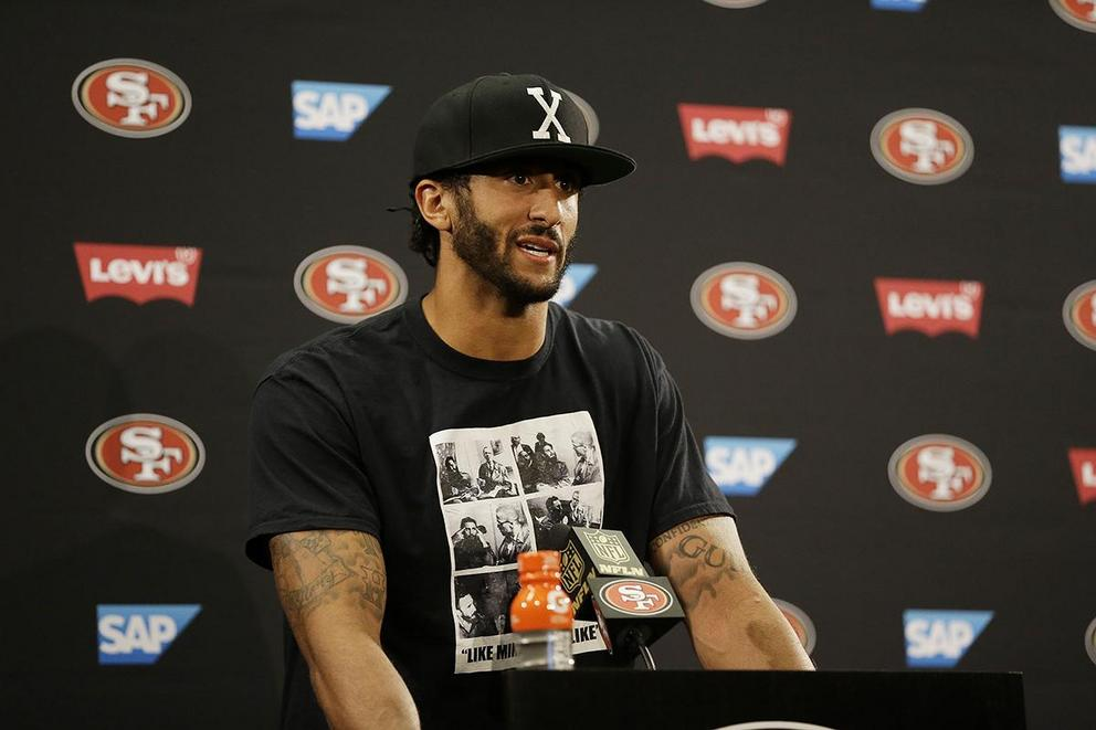 Should Colin Kaepernick remain seated for national anthem as a form of protest?