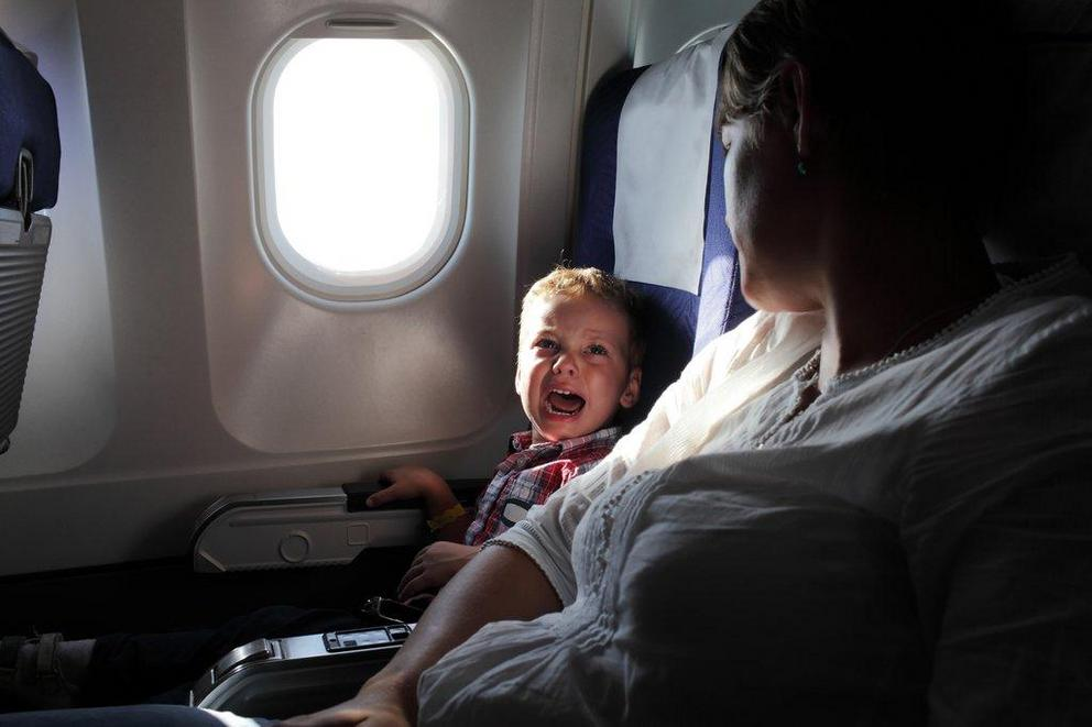 Should planes have child-free zones?