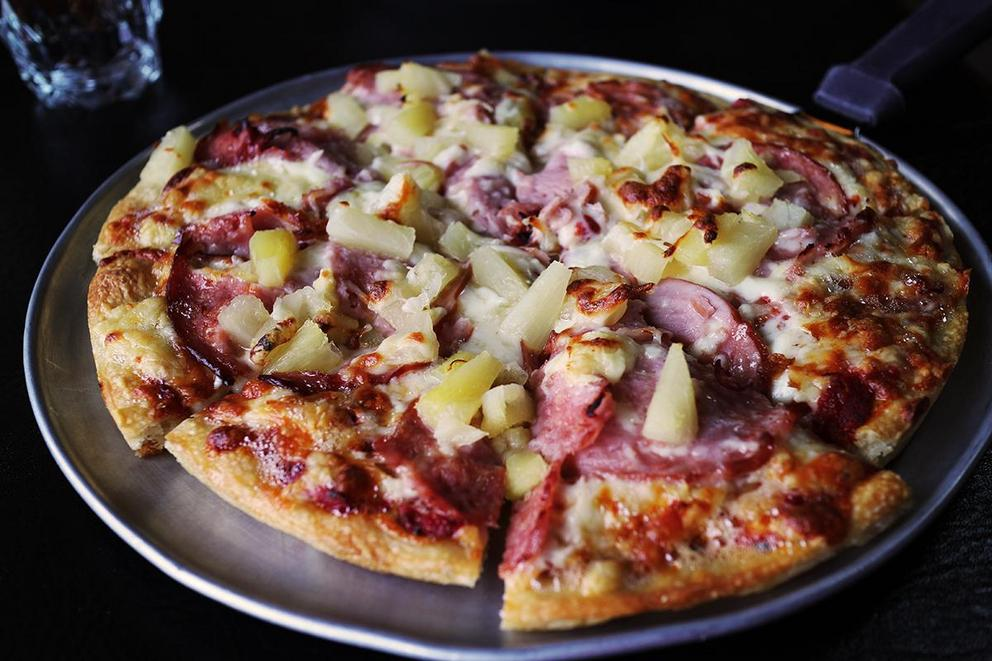 Is it evil to put pineapple on pizza?