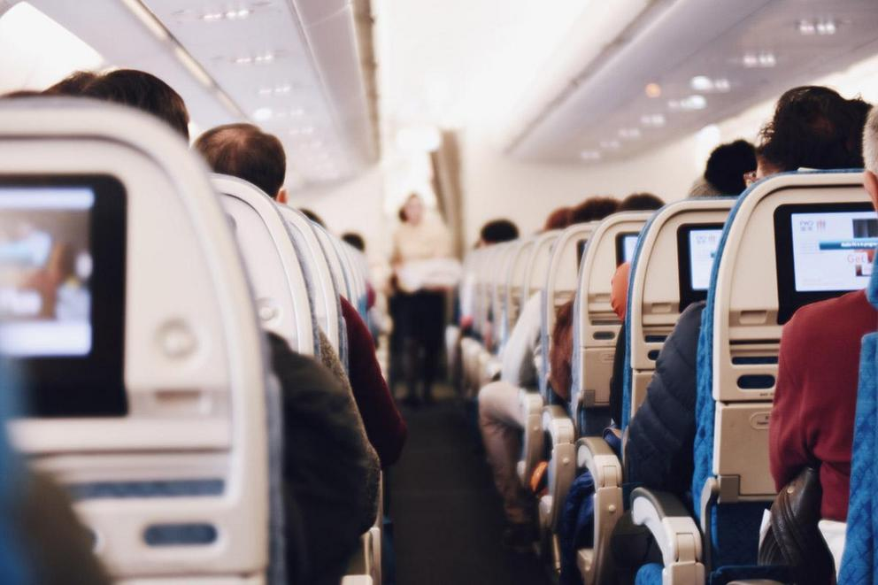 Is it okay to lean your seat back on a plane?
